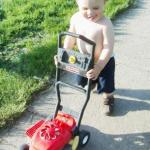 micah mowing.jpg